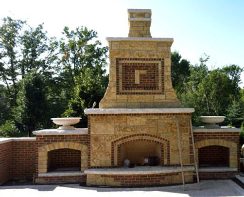 Stone And Brick Fireplace stone and brick fireplace anchor this outdoor livingroom